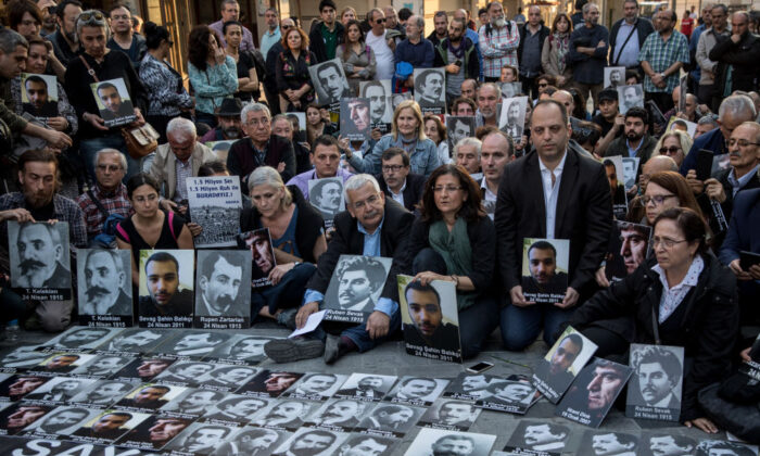 ISTANBUL, TURKEY - APRIL 24: People hold pictures of victims during a memorial to commemorate the 1915 Armenian mass killings on April 24, 2018 in Istanbul, Turkey. People gathered to mark the 103rd anniversary of the slaughter of up to 1.5million Armenians by the Ottoman government in an event many view as genocide. (Photo by Chris McGrath/Getty Images)