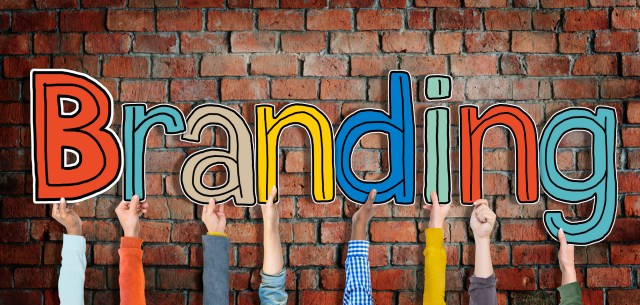 Multiethnic Group of Hands Holding Word Branding - concorrência