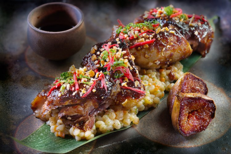 Charred Duck confit on a bed of Barley risotto