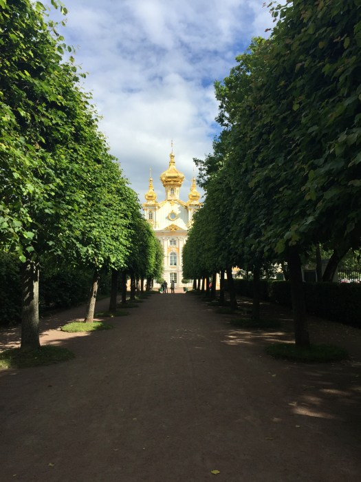 A view of the church at the gorgeous Peterhof or Summer Palace through the gardens