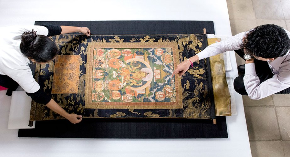 This thangka painting (chundhaa) on silk from Nepal (1698 ce) is being mounted onto a stretcher due to damage to its paint layers