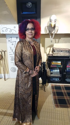 Egyptian author Mona Eltahwy posing for Parmesh in Abraham and Thakore at Bungalow 8