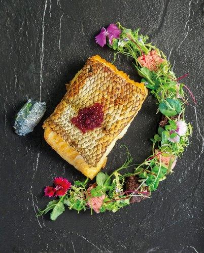 Slow-poached sea bass, raspberry microwave sponge and caviar, basil seed jelly, sea-sand dust