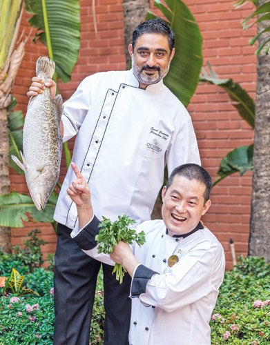 Left to right: Chef Sunil Gadihoke and Chef Yuanzhong Jia