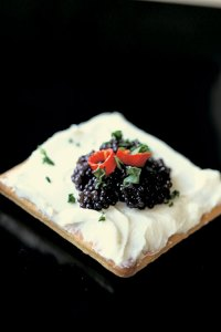 Caviar on a cream smeared cracker