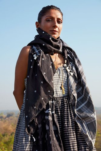 Scarf, slip dress, both from Injiri; neck chains with charms, all from Nicobar.