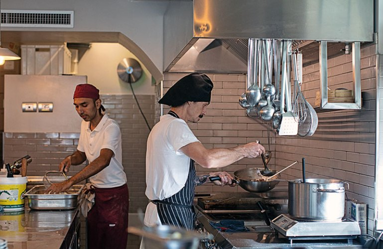 The main chefs preparing orders in their open kitchen