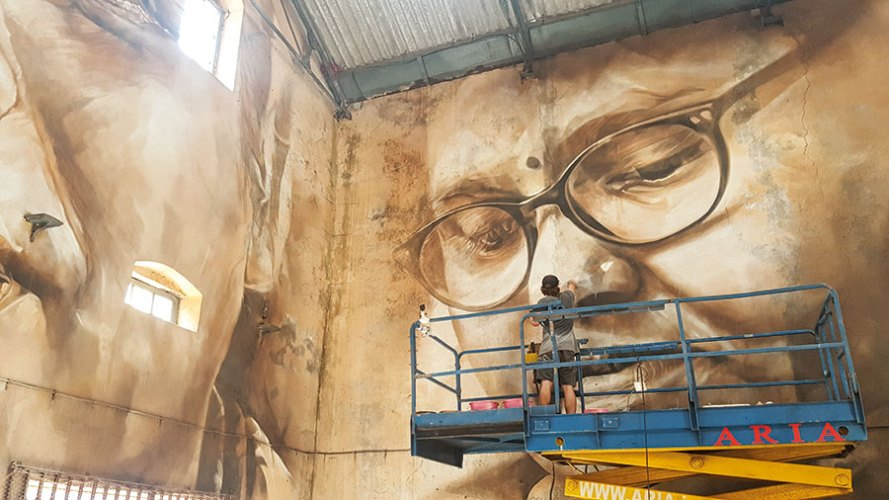 Guido Van Helten at work on his mural