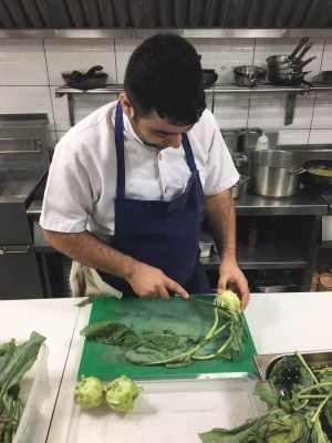 Chef Prateek prepping Kohlrabi for lamb breast and sunchokes