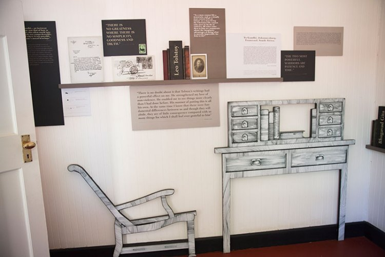 Gandhi's room has been recreated with furniture and wall murals