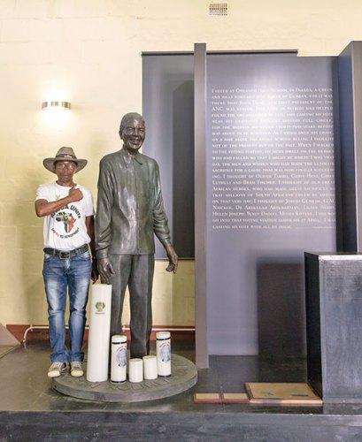 Mandla Nxumalo with the statue of Nelson Mandela