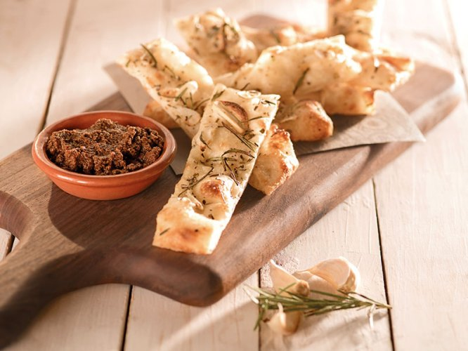 Hand-stretched garlic bread with rosemary and  olive tapenade