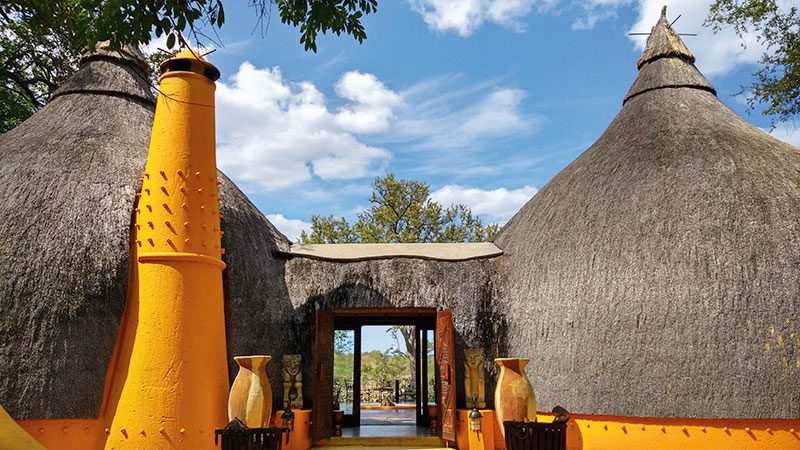 Stay in traditionally built (but luxurious) African huts at the Hoyo Hoyo safari lodge
