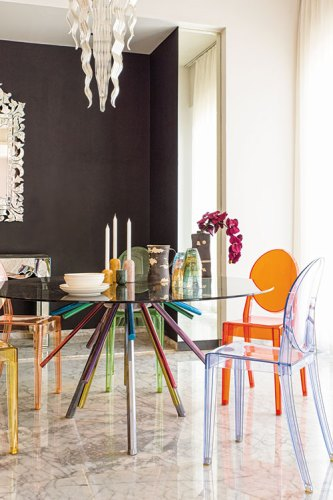 Versace Dining Table; Kartell Chairs by Philippe Starck; Chandelier by Baccarat; Cosmos Candle Holders by KOY