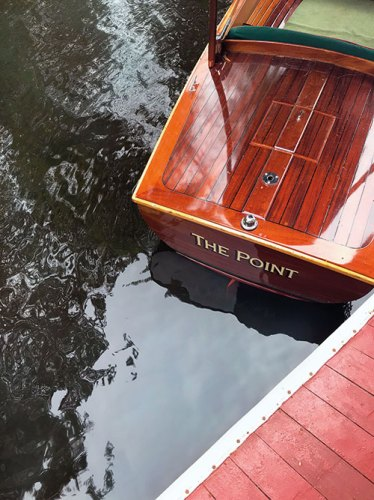 One of the six wooden boats for guests to use