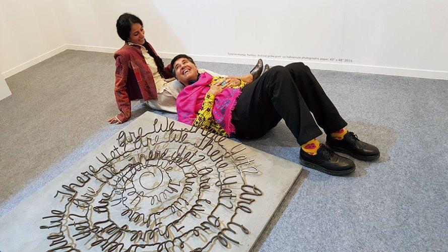 Parmesh Shahani with artist Suruchi Choksi and her sculpture at India Art Fair
