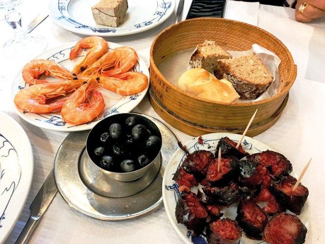 Selection of Corn Bread, Chourico, Olives and Shrimp at a Cabana