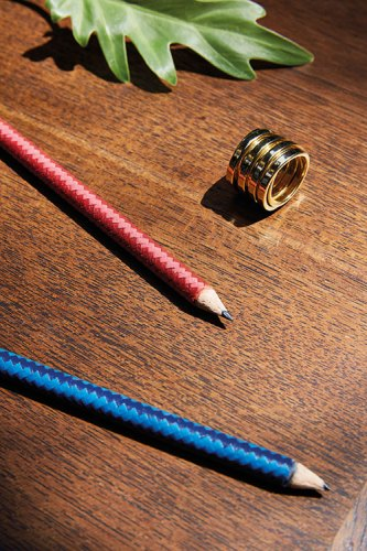 Spiral golden ring, from Metallurgy, New Delhi. Arlequin Pencil in Goatskin by Hermès