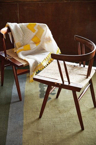 Appliqué skirt, from Pankaj & Nidhi, New Delhi. Grass-Seated Chair by George Nakashima, 1940s. Courtesy of Saffronart