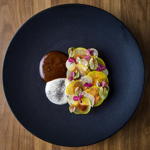 Pork in 'chile pasado', potatoes and roasted seasonal fruits infused in 'chiles'