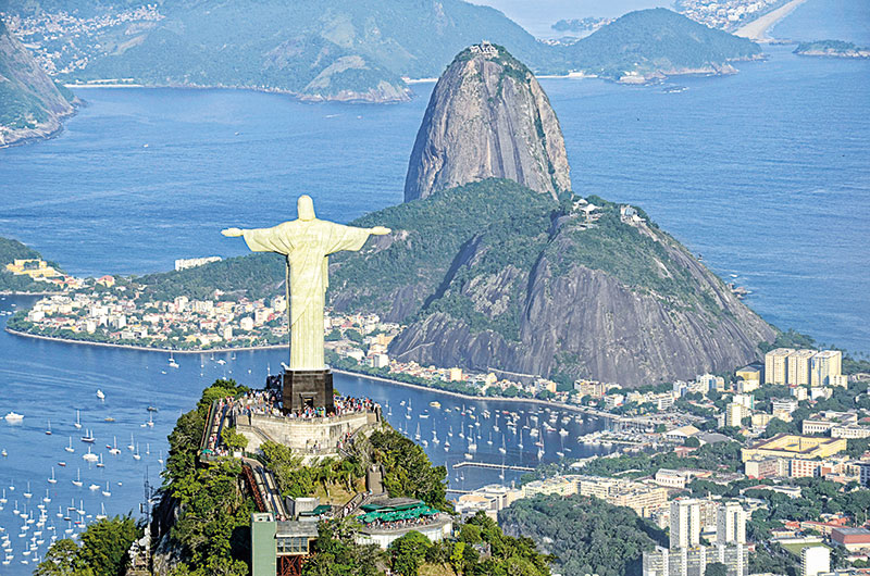 The iconic statue of christ the redeemer watches over the landscape of Rio de Janeiro, Rio de Janeiro, Brazil, South America
