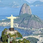 The iconic statue of christ the redeemer watches over the landscape of Rio de Janeiro, Rio de Janeiro, Brazil, South America