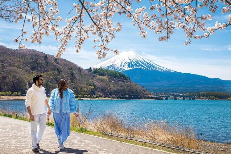 Munjal and Taneja at Mt. Fuji, Japan, during cherry blossom season
