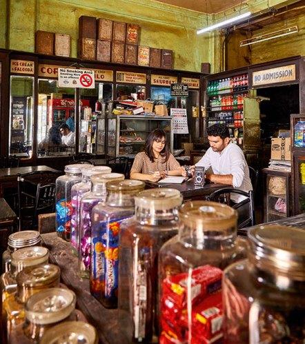 Simin Patel and Hashim Badani exchange notes at Café Dela Paix