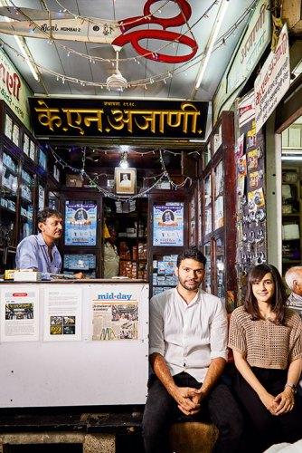 Simin Patel and Hashim Badani sitting at the entrance of K. N. Ajani