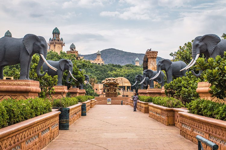 Elephants keep watch over the resort's Bridge of Time