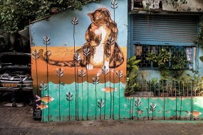 A cat mural in Pali Village by Artists Tika and Anpu