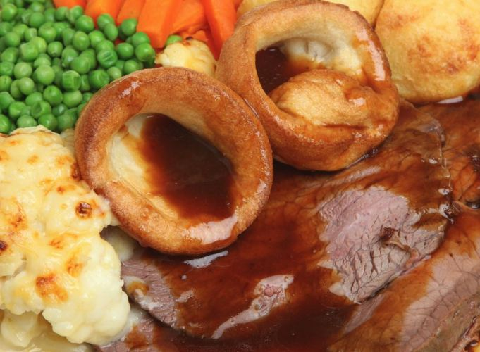 Traditional Sunday roast beef dinner with Yorkshire pudding and gravy