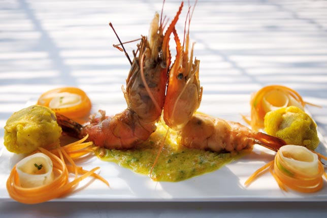 Continental grilled tiger prawn in Mango Moilly, a mildly spiced gravy of shallots, mango and coconut milk