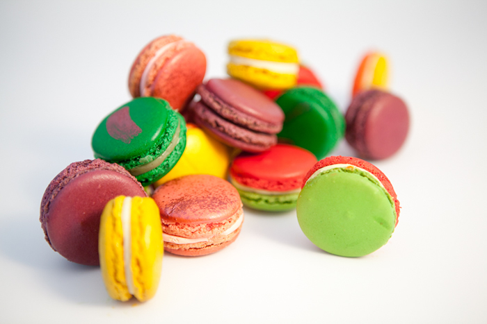 Assorted macarons, cherry pistachio, cream cheese and passion fruit, paan gulkand