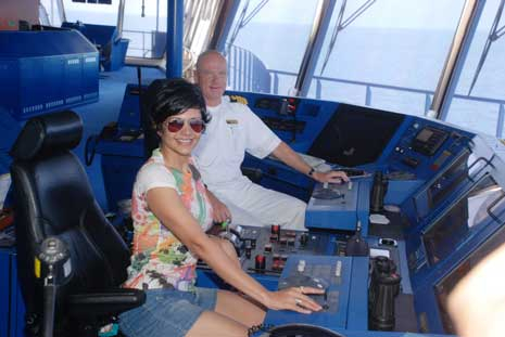 Mandira Bedi: Pushing buttons at the captain's seat on the Super Star Cruise Virgo