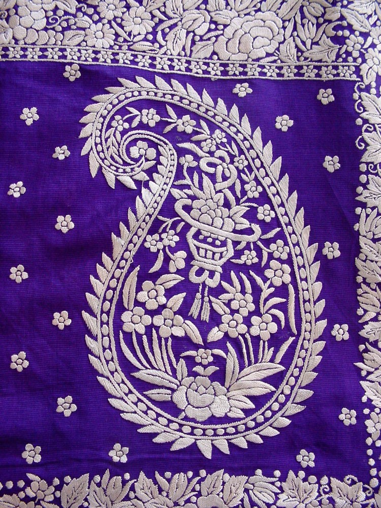 Intercultual amalgam is seen in this Indian paisley with a Chinese basket of riches within