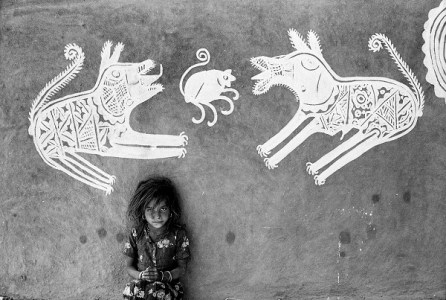 A young girl in front of mandana paintings, Jyoti Bhatt