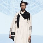 A model at the Ode to Weavers show by Injiri; Lakme Fashion Week. She is wearing an Injiri organic cotton dress, a khadi skirt and an ikat scarf