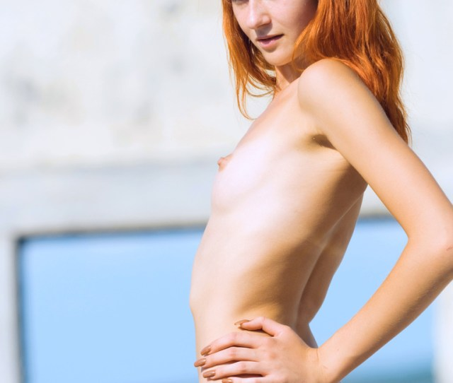 The Innocent Redhead Girl Posing Absolutely Nude Her Little Tits In Front Of The Photo Camera