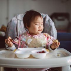 Toddler Chair Booster Seat Desk Chairs Without Wheels When To Transition From High Lovely Little Baby Enjoying Breakfast By Herself