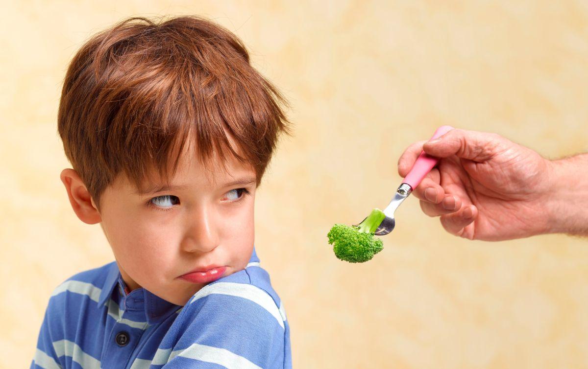 boy refusing to eat his vegetables 864522824 5c4b4f5546e0fb00018de8ec