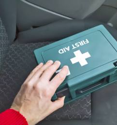 first aid box sitting on the seat of a car [ 1942 x 1543 Pixel ]