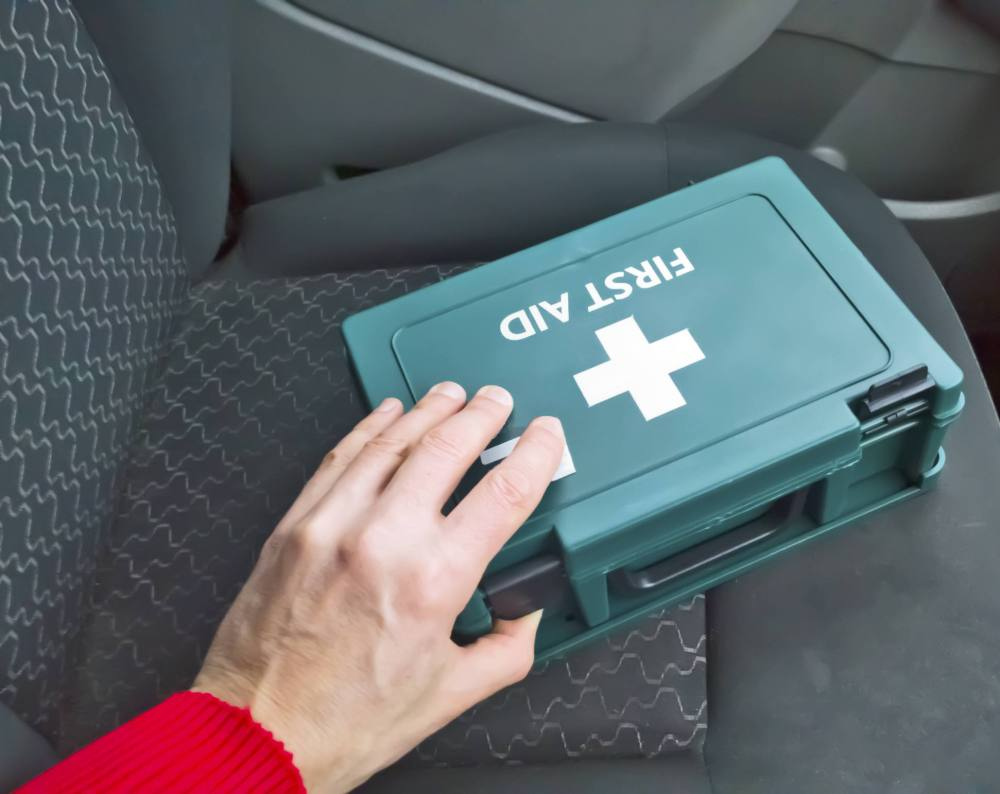 medium resolution of first aid box sitting on the seat of a car
