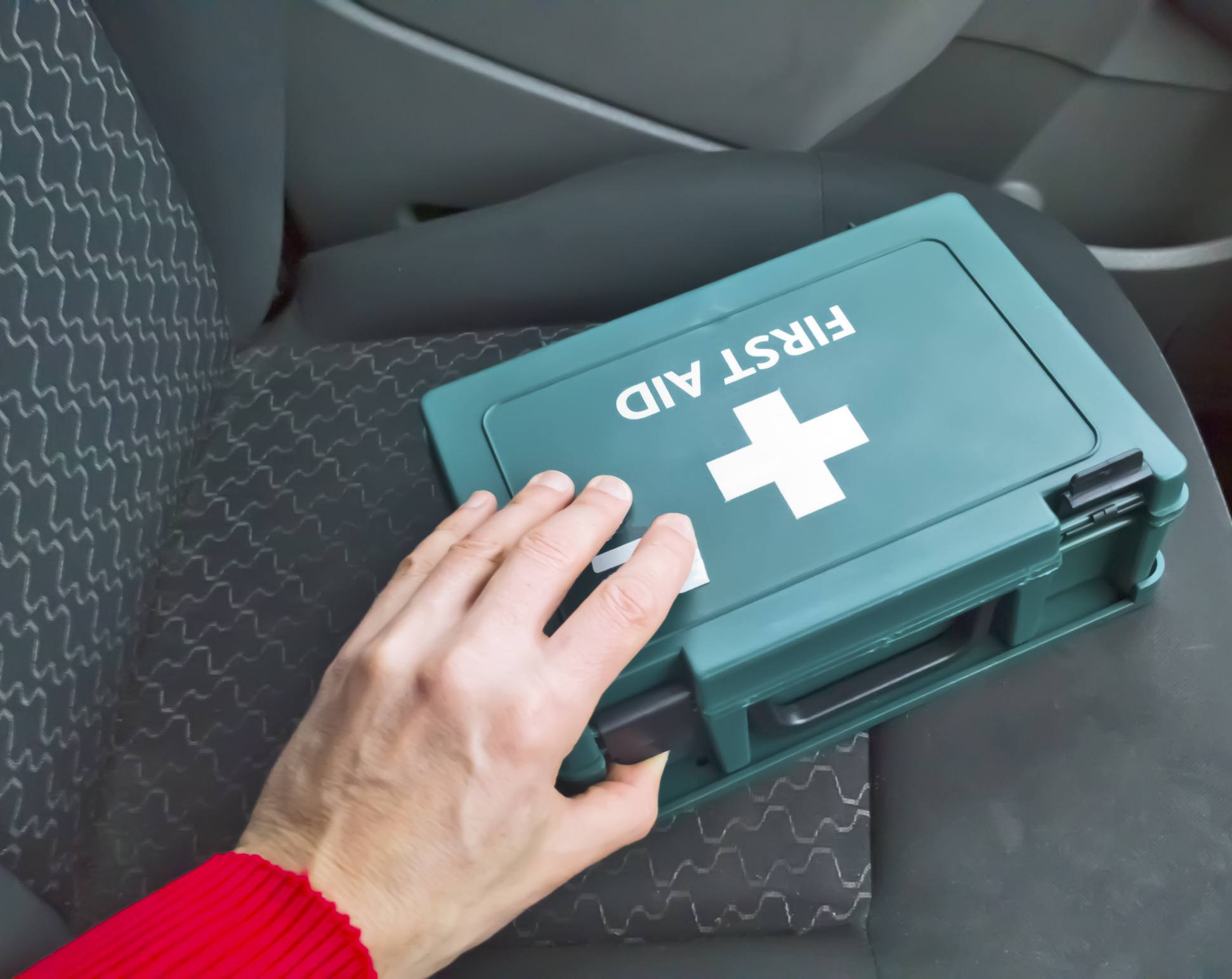 hight resolution of first aid box sitting on the seat of a car