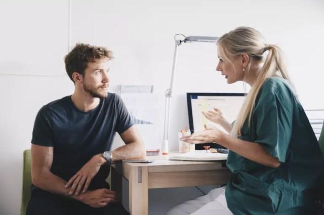 female nurse talking to man