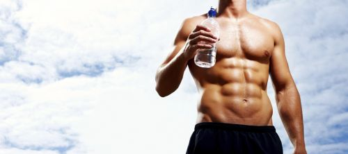 small resolution of mid section of muscular man with bottle aganist cloudy sky