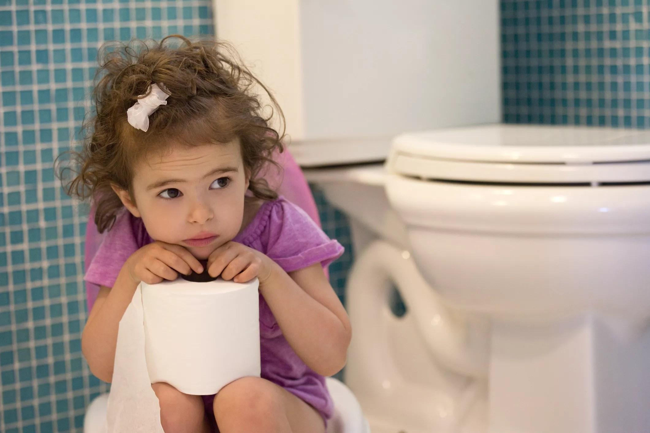 little girl anxious near toilet