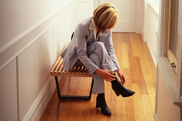 Woman taking off shoes