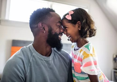 Man and daughter smiling with happiness