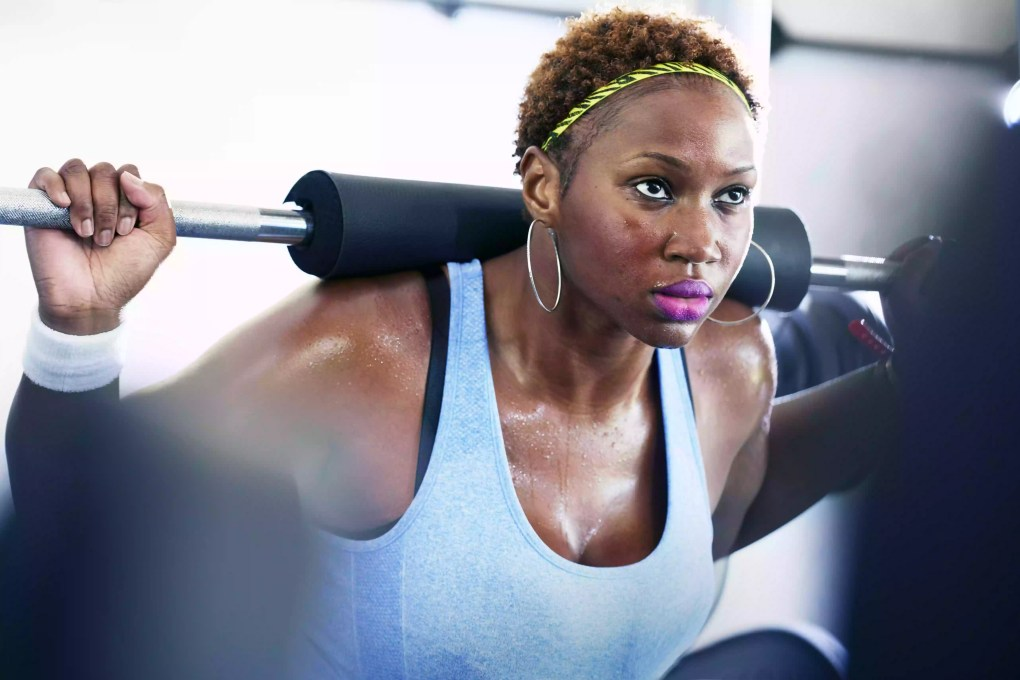 woman lifting weights at the gym